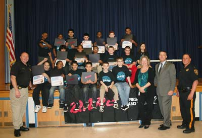 DARE Graduates with seated with Teachers and Sheriff Frank Balles