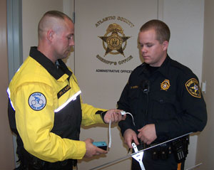 Officers using project lifesaver locator technology